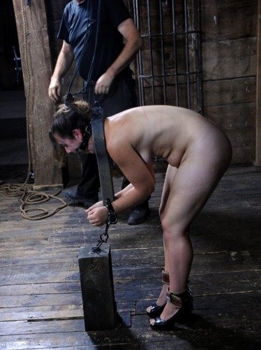 sasha restricted and chained in metal bar